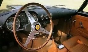 Inside the 1957 Superamerica, the driver faced a big speedometer and tachometer; the auxiliary gauges were mounted in the center of the dash.