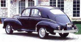 The 203 received chrome bumpers in 1952 and a larger rear window in 1954.