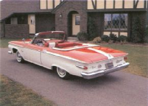 The fins on the 1961 Plymouth Fury were planed down and bent over to shield bullet-style taillights.