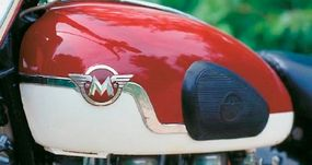 """The """"winged M"""" was the logo of the Matchless brand. On AJS versons of this bike, called the Model 31, """"AJS"""" replaced the """"M."""""""