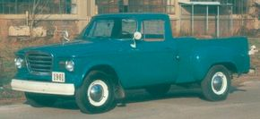 The Studebaker Champ pickup's front styling was borrowed from the Lark car. Small grilles inboard of the headlamps identify this 1961 Champ from a 1960. See more classic truck pictures.