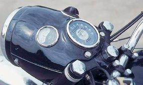 The bullet headlight housing containing the light switch, ammeter, and speedometer was considered sleek in its day.