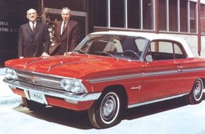 Oldsmobile General Manager Jack Wolfram (left) and Chief Engineer Harold Metzel pose with the 1962 Oldsmobile F-85 Jetfire.