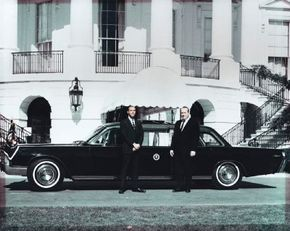 George Lehmann (left) and Robert Peterson pose at the White House with the presidential limousine they were contracted to build.