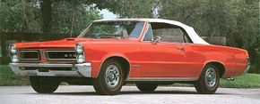 A 1965 facelift brought vertical headlights and a full-width taillight.
