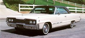 The dumbbell-shaped front end on this 1964 model was picked up on the 1965 Polara and Monaco. See more classic car pictures.