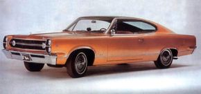 ©2007 Publications International, Ltd.                                      The 1967 AMC Marlin rode the Ambassador's 118-inch wheelbase, with the extra four inches ahead of the cowl.
