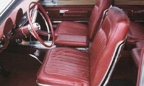 Two large dash pods continued to house essential gauges in the restyled center console nestled between the front bucket seats.