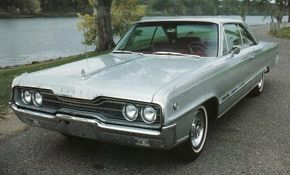 """For 1966, the """"barbell"""" effect of the Monaco 500's grille became more pronounced, and a forceful speedline thrust forward from the front wheel openings. Round """"500"""" medallions and the three faux vents on the bodysides were Monaco 500 traits."""