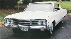 """The 1967 Dodge Monaco 500 put on 85 pounds, tipping the scale at 3,970 pounds at its most basic. The broad rocker panel trim design was adopted for Dodge's line leader. Free-standing numerals counted out """"500"""" on the front fenders."""