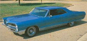 The 1966 Pontiac Grand Prix was little changed from the 1965 models, save for a mild facelift.