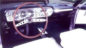 The 1965 Chevelle is equipped with a faux-wood sports steering wheel.