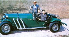 Designer Brooks Stevens (standing) along with sons William and David, pose with an Excalibur. See more classic car pictures.
