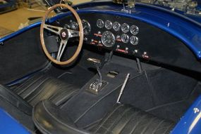 The 1966 Shelby Cobra 427 Super Snake was a race car modified for street use. Its 800-horsepower V-8 links to a three-speed automatic transmission.
