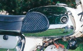 The twin-cylinder two-stroke featured oil injection.