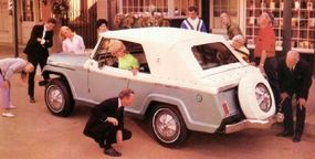 A continental spare tire identified the Jeepster Convertible.