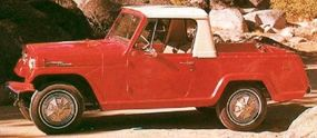 This Jeepster Pick-Up featured sporty full wheel covers with fake knock-off hubs.