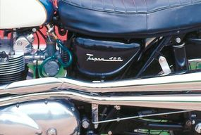 Befitting its off-road capability, the Tiger T100C's dual exhaust pipes were high-mounted.