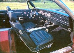 """The 1969 Chrysler Three Hundred came standard with individual """"pleated-and-pillowed bucket seats"""" divided by a center cushion and armrest."""