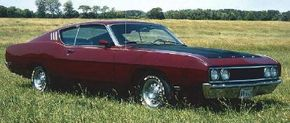 The 1969 Ford Talladega was named for NASCAR's newest super speedway and wore a nose shaped to slice the wind at 200 mph. Ford built 745 of these modified Torino for the street. That made racing versions legal. See more pictures of muscle cars.