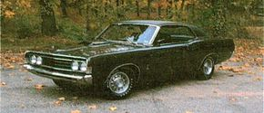 The 1969 Ford Cobra came standard with a 428 Cobra-Jet rated at 335 bhp.