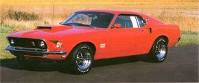 The front-heavy Boss 429 required sheetmetal and suspension alterations to make it fit. See more classic car pictures.