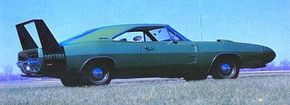 Conceived as an aerodynamic weapon for the NASCAR circuit, the 1969 Dodge Charger Daytona wore a pointed 18-inch nose, along with a rear spoiler that towered two feet above the trunk. See more classic car pictures.