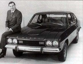 William Benton, Lincoln-Mercury general manager, rests on a 1973 Capri, which was sold as a Mercury in the U.S. See more classic car pictures.