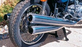 The three-pipe exhaust system mounted two pipes on one side, one on the other.