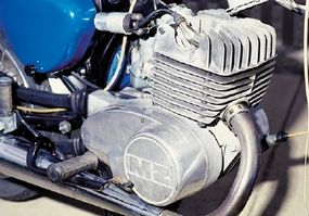 The single-cylinder two-stroke is no road burner, but it isn't meant to be.