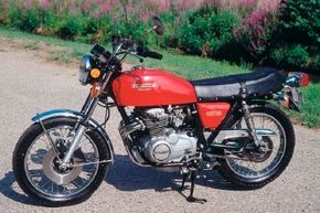 The Honda CB400 was an updated version of the 350, but with a more racer-like look and feel. See more motorcycle pictures.