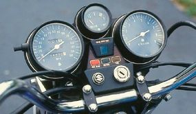 The water-cooled engine required a coolant-temperature gauge, and it was mounted between the speedometer on the left and the tachometer on the right.