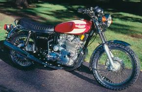 The 1975 Triumph Trident was updated to appeal to American tastes and laws, but its three-cylinder design would be dropped after 1976. See more motorcycle pictures.