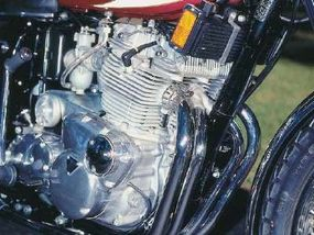 This second-generation Triumph triple was updated with an electric starter and cylinders that went from vertical to slightly inclined.