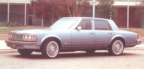 A vertical-bar grille was new to the 1977 Seville. So, too, was the availability of a painted metal roof.