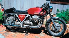 The 1973 Moto Guzzi V7 Sport' s mechanical layout promoted a low seat height, low handlebars, and a low center of gravity for good handling. See more motorcycle pictures.