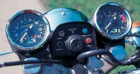 The speedometer and tachometer were augmented by a quartet of warning lights. The switch for the new electronic ignition is in the center.