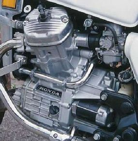 The CX500's engine was unusual, too. The crosswise, water-cooled V-twin had four valves per cylinder, but used pushrods instead of overhead cams.