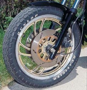 Gold trim dressed the wheels and all three disc brakes.
