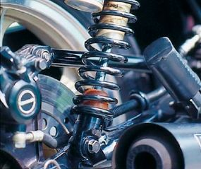 """Suspension of the KZ1000R included gold-painted """"piggyback"""" reservoir rear shocks."""