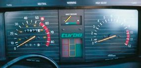 A boost gauge in the upper center of the instrument panel kept track of turbo pressure.