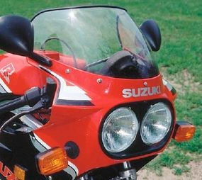 Trend-setting dual round headlamps were set into a full fairing.