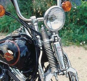 The spring front fork was similar to those offered by Harley-Davidson prior to 1949, though it added a shock absorber to improve control.
