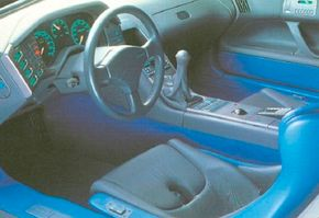 The 1988 Peugeot Oxia concept car interior drew on solar cells for electrical power. The dashboard included a computer and a map display.