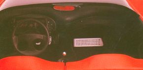 The 1989 Ferrari Mythos concept car cockpit stressed symmetry. The shape of the analog instrument panel was echoed by the steering wheel.
