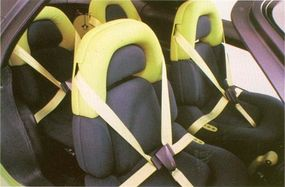 Rear passengers were guaranteed a tight fit in colorful seats.