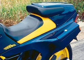 A driver's backrest is incorporated into the tail section.