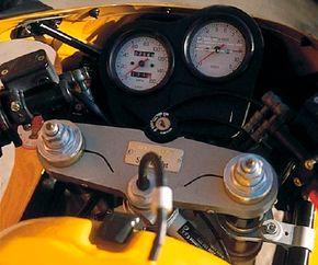 The tachometer redlines at 9000 rpm.