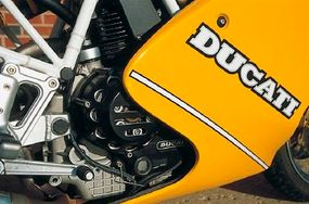 The 904-cc Pantah V-twin uses a cogged belt to drive the camshafts.