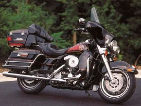 The FLHTC Electra-Glide is loaded with comfort and convenience features including electronic cruise control and air-adjustable suspension. See more motorcycle pictures.